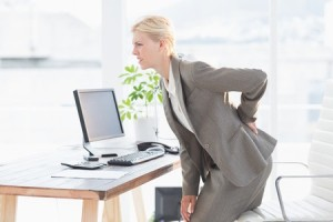 42576909 - sad businesswoman having back pain in her office