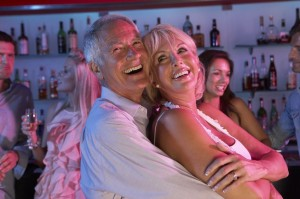 9911258 - senior couple having fun in busy bar
