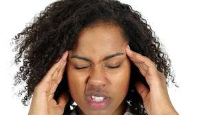88131704 - frustrated black woman with headache isolated on white background
