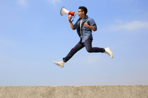 36620542 - man jump and shout by megaphone with blue sky background, asian