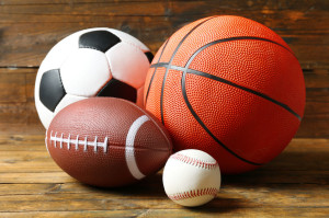 50048676 - sports balls on wooden background
