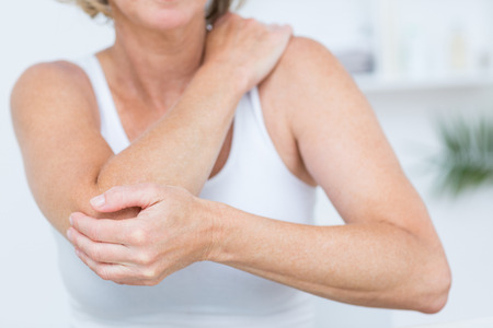 39828488 - woman having elbow pain in medical office