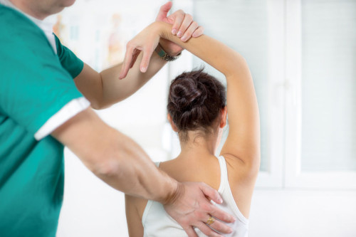 26504084 - chiropractor massage the female patient spine and back