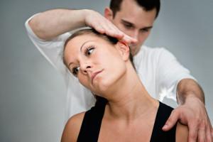 53709121 - chiropractic adjustment - chriopractor working on patient's neck